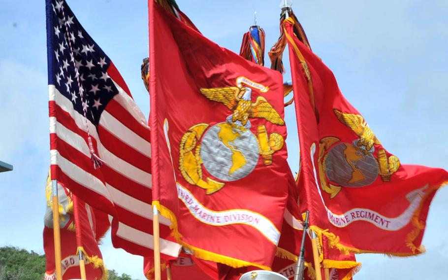 Flags from the Okinawa-based 3rd Marine Division's color guard are seen during a Liberation Day parade in Hagatna, Guam, July 21, 2017.