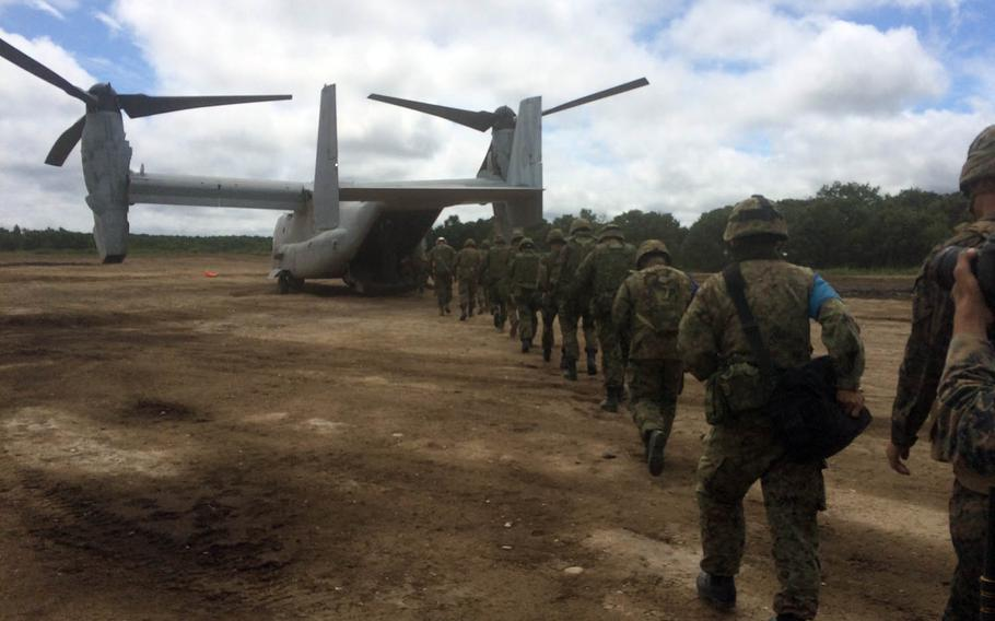 Okinawa-based Marines and Japan Ground Self-Defense Force troops load into an MV-22 Osprey during Northern Viper drills in Hokkaido, Japan, Friday, Aug. 18, 2017.