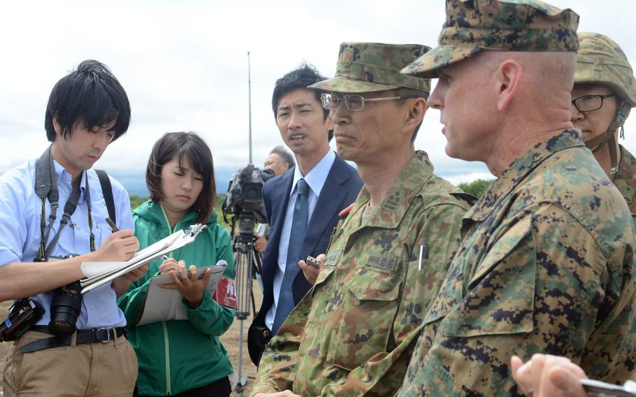 Marine Corps and Japan Ground Self-Defense Force officials speak to reporters about the MV-22 Osprey tilt-rotor aircraft's participation in Northern Viper drills in Hokkaido, Japan, Friday, Aug. 18, 2017.