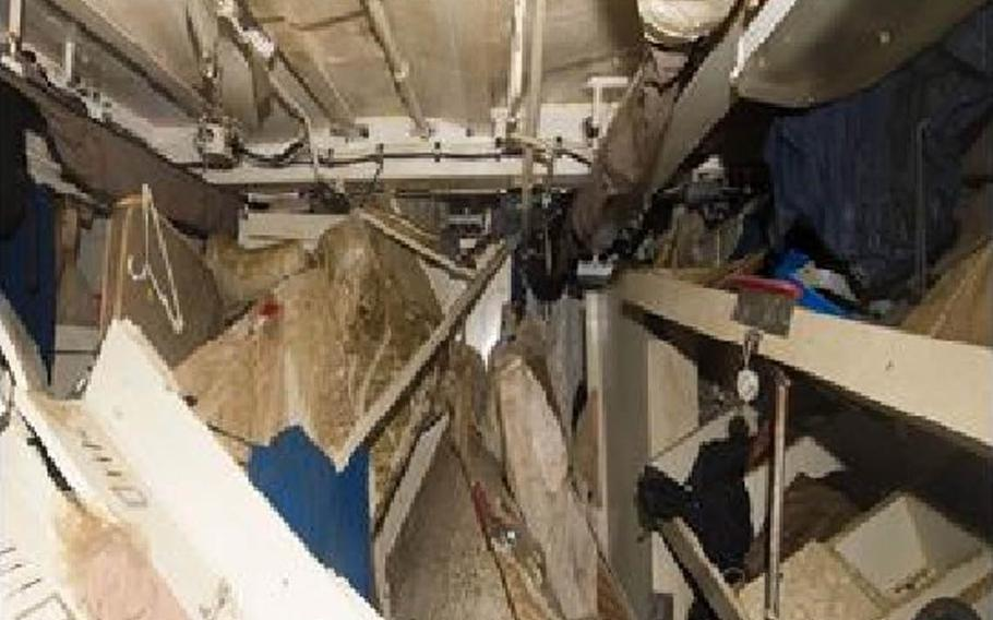 This screenshot taken from a Navy investigative report shows racks in Berthing 2 after the USS Fitzgerald was drained of floodwaters.