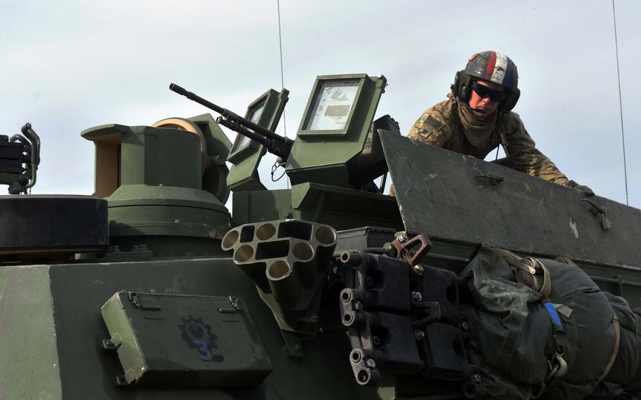 U.S. Army Tanker Spc. Emmett Fulgham prepares his tank for a live fire exercise, Aug. 18, 2017, in Grafenwoehr, Germany.
