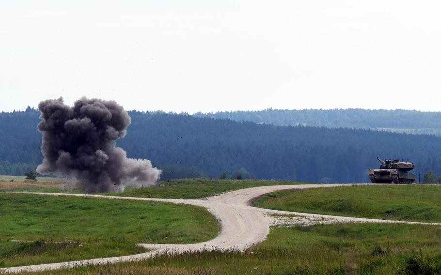 U.S. soldiers in an M1A2 Abrams tank observe a Bangalore torpedo explode during a breach-clearing exercise, Aug. 18, 2017, in Grafenwoehr, Germany.