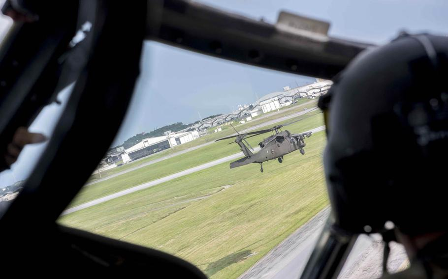Army Black Hawk helicopters take off in formation at Kadena Air Base, Japan, Aug. 1, 2017.