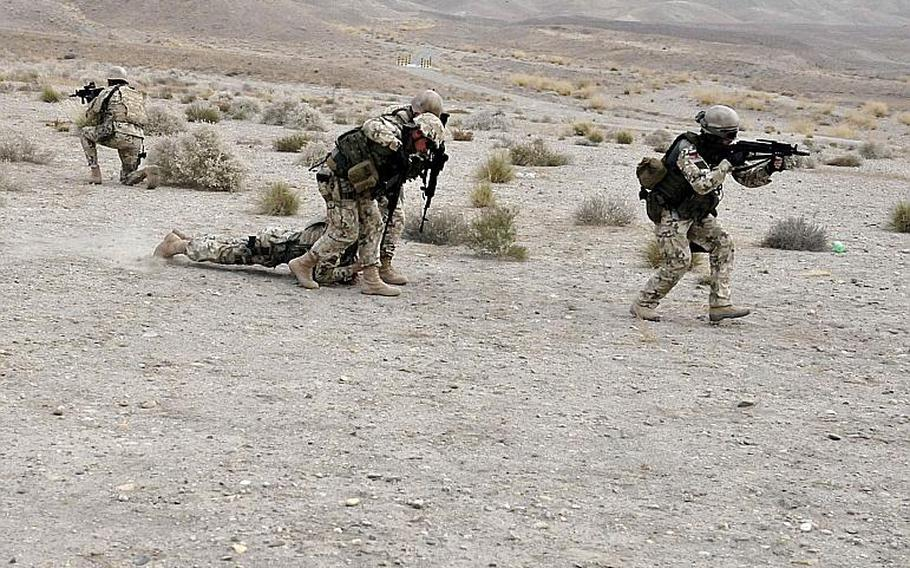 Infantry soldiers from the Polish army's 21st Mountain Brigade conduct drills near TB Gamberi in Afghanistan in 2014. Allies are developing plans to prepare for future battlefields that experts believe are more likely to be urban.