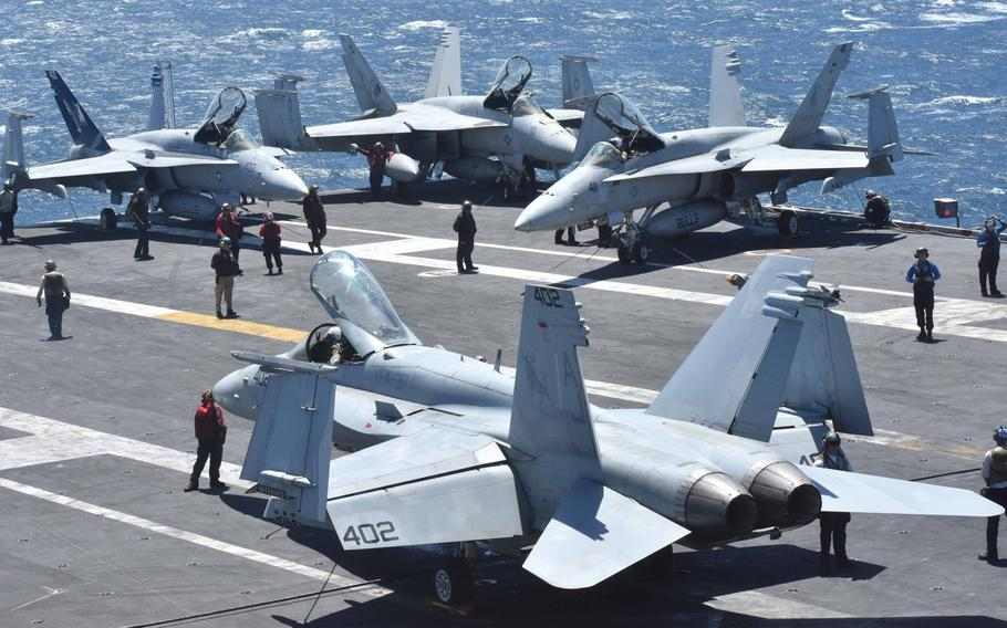 Crews fire up a cluster of F/A-18 Super Hornets as part of pre-flight preparation on the USS George H.W. Bush in the Persian Gulf in April, 2017.