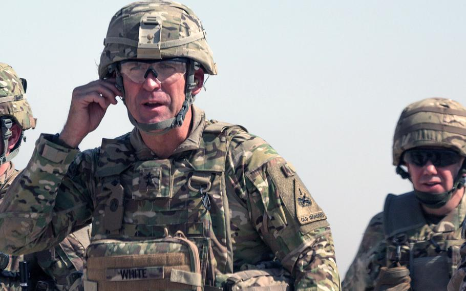 U.S. Army Maj. Gen. Robert White, commanding general of Combined Joint Forces Land Component Command-Operation Inherent Resolve, (left), arrives at the Besmaya Range Complex, Iraq, July 17, 2017.
