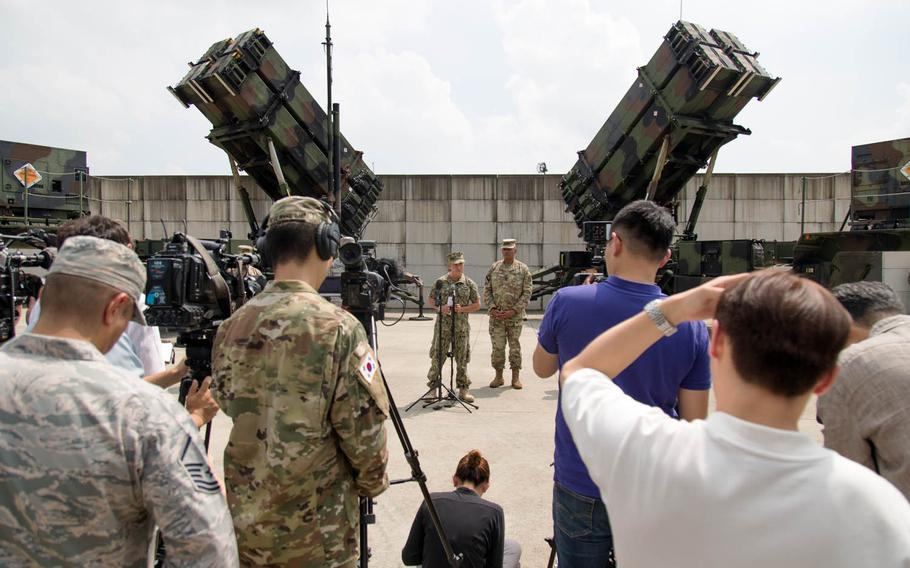 Adm. Harry Harris Jr., left, head of U.S. Pacific Command, speaks to reporters at Osan Air Base, South Korea, Tuesday, Aug. 22, 2017. Gen. Vincent Brooks, commander of U.S. Forces Korea, stands at his left.