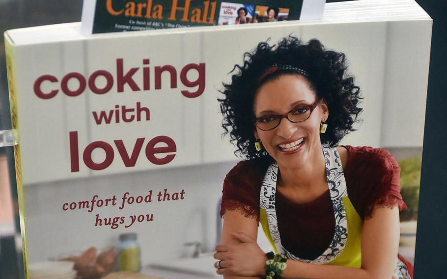 """Celebrity chef Carla Hall is currently working on her third book. Her first, """"Cooking with Love,"""" was on sale at the AAFES exchange at Aviano Air Base on Wednesday, Aug. 23, 2017, for fans to pick up a copy and get it autographed."""