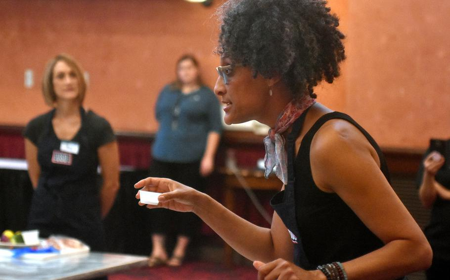 Celebrity chef Carla Hall talks about using the correct amount of salt during a cooking demonstration Wednesday, Aug. 23, 2017, at La Bella Vista Club at Aviano Air Base, Italy.