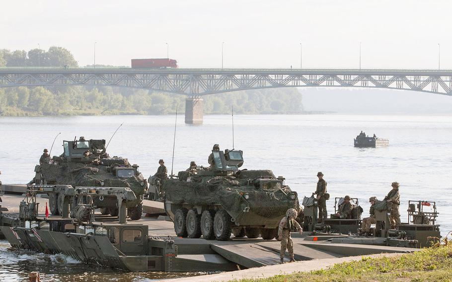 U.S. Army Strykers belonging to the 2nd Cavalry Regiment cross the Vistula River in Chelmno, Poland, on Wednesday, June 8, 2016. An Inspector General's report, released this week, cautioned that the resources for carrying out the military's European Reassurance Initiative could fall short of the demands of a campaign designed to reinforce NATO's eastern flank.