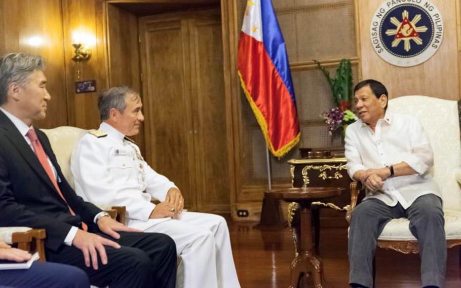 U.S. Ambassador to the Philippines Sung Kim, left, Commander of U.S. Pacific Command Adm. Harry Harris Jr., and Philippine President Rodrigo R. Duterte meet at Malacanan Palace in the Philippines, Wednesday, Aug. 23, 2017.