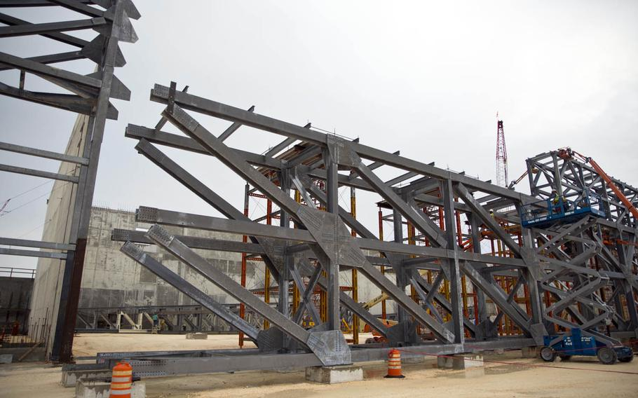 A hangar for Marine Corps MV-22B Ospreys stands partially constructed last year at Andersen Air Force Base, Guam.