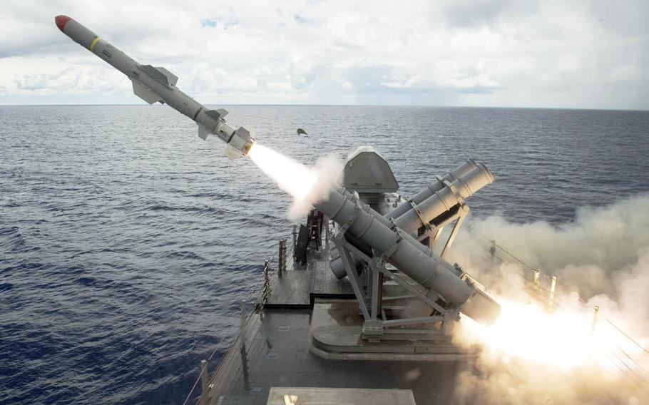 A harpoon missile launches from the missile deck of the littoral combat ship USS Coronado off the coast of Guam, Tuesday, Aug. 22, 2017.