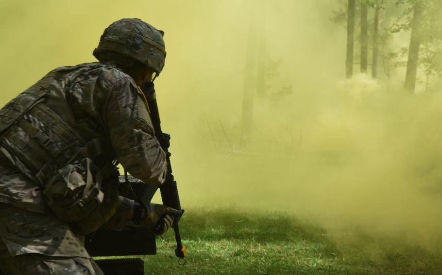 Sgt. Antonio Hernandez, a soldier with the 173rd Brigade Combat Team, advances through the smoke during the U.S. Army Europe Best Warrior Challenge, Aug. 22, 2017, at Grafenwoehr, Germany.   Martin Egnash/Stars and Stripes