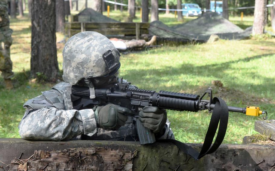 Staff Sgt. Burnell Stewart, a soldier with the U.S. NATO Brigade, takes aim during the U.S. Army Europe Best Warrior Challenge, Aug. 22, 2017, at Grafenwoehr, Germany.   Martin Egnash/Stars and Stripes