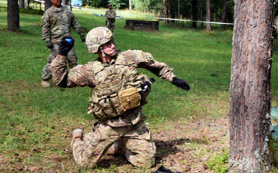 Lt. Maclean Lalor, a soldier with the 173rd Brigade Combat Team, throws a practice grenade during the U.S. Army Europe Best Warrior Challenge, Aug. 22, 2017, at Grafenwoehr, Germany.   Martin Egnash/Stars and Stripes