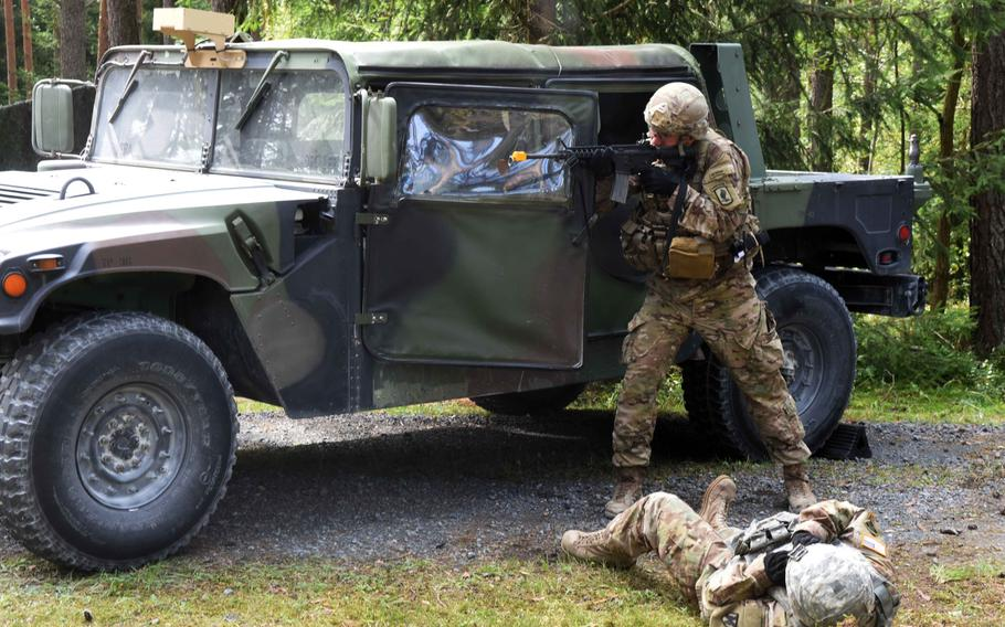 Lt. Maclean Lalor, a soldier with the 173rd Brigade Combat Team, takes aim behind a Humvee during the U.S. Army Europe Best Warrior Challenge, Aug. 22, 2017, at Grafenwoehr, Germany.   Martin Egnash/Stars and Stripes