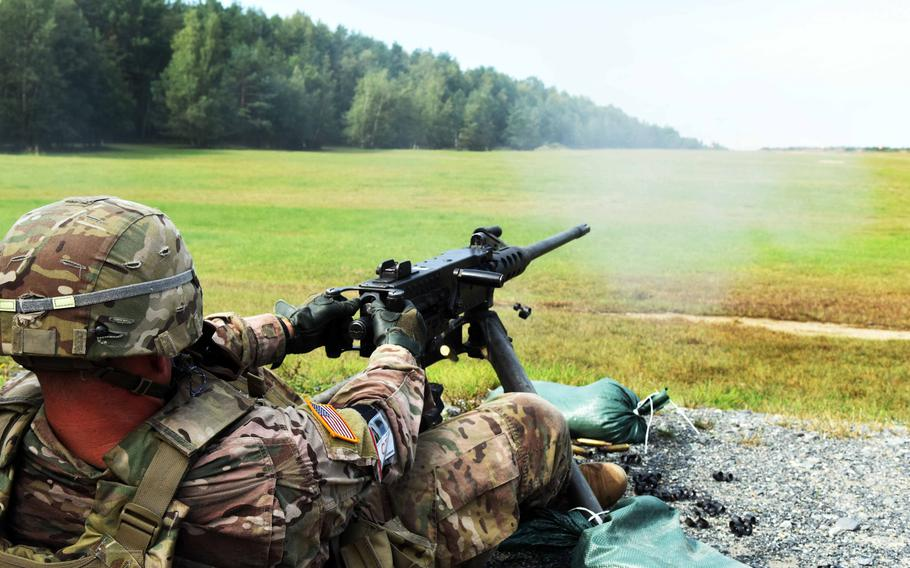 Lt. Christopher Finseth, a soldier with U.S. Army Africa, fires a 50-caliber machine gun during the U.S. Army Europe Best Warrior Challenge, Aug. 22, 2017, at Grafenwoehr, Germany.   Martin Egnash/Stars and Stripes