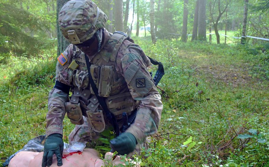 Lt. Jean Domguia, a soldier with the 2nd Theater Signal Brigade, conducts first aid procedures on a dummy during the U.S. Army Europe Best Warrior Challenge, Aug. 22, 2017, at Grafenwoehr, Germany.   Martin Egnash/Stars and Stripes