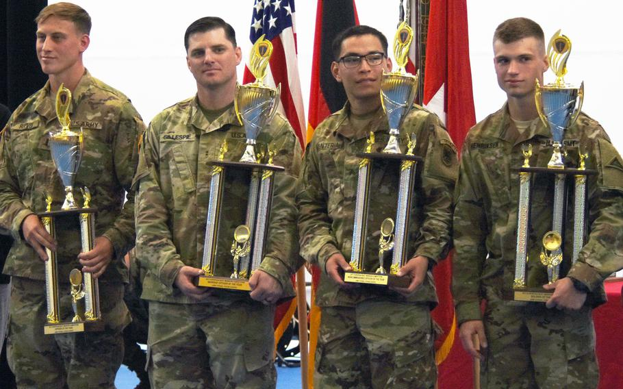 The winners of the U.S. Army Europe Best Warrior Challenge Lt. Christian Reeves, left, CW2 Kristopher Gillespie, Sgt. Jonathan Renteria, and Spc. Jacob Henriksen, right, stand after receiving their trophies, Aug. 25, 2017, at Grafenwoehr, Germany.    Martin Egnash/Stars and Stripes
