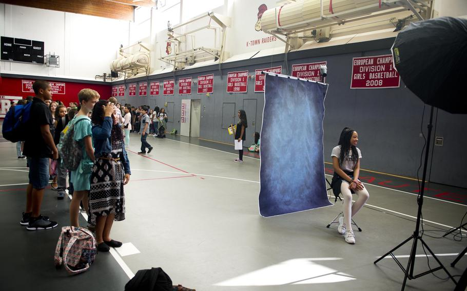 Sixth-grade students at Kaiserslautern Middle School get their pictures taken during the first day of school at Vogelweh, Germany, on Monday, Aug. 28, 2017.