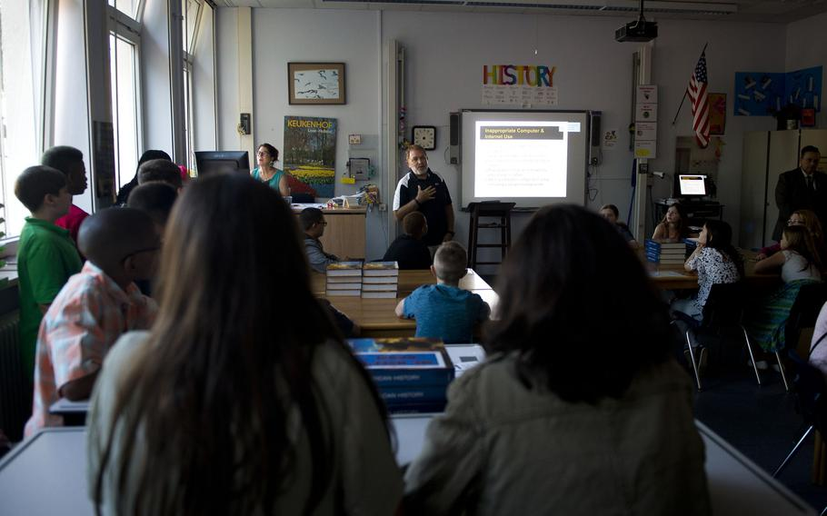 Kevin Morris, an education technologist at Kaiserslautern Middle School, speaks with students about proper internet usage during the first day of school at Vogelweh, Germany, on Monday, Aug. 28, 2017.