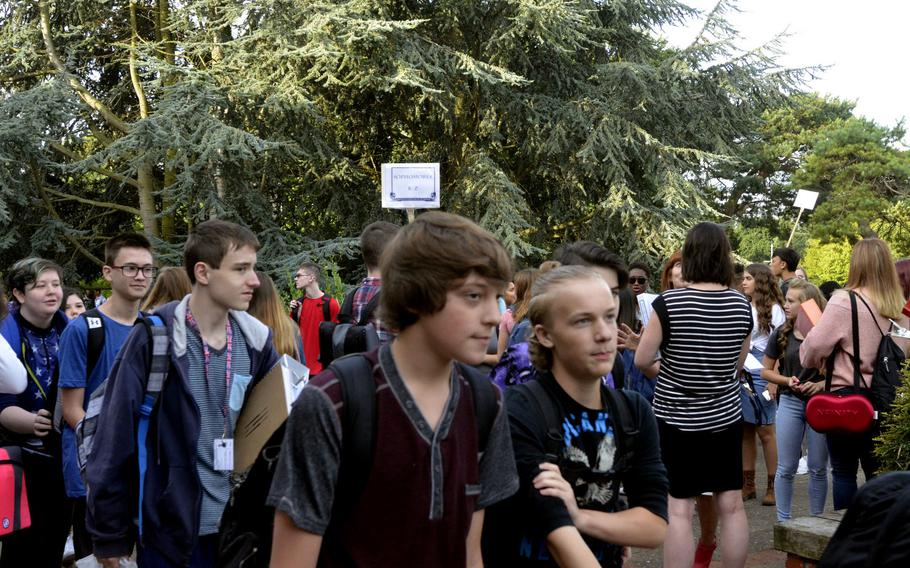 Lakenheath American High School students walk to their assigned areas for orientation on the first day of school at RAF Lakenheath, England, Monday, Aug. 28, 2017.