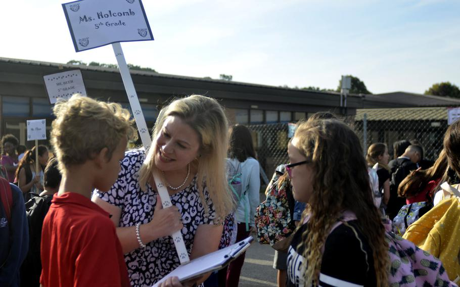 Fifth-grade teacher Shannon Holcomb meeting her new students during the first day of class at the Liberty Intermediate School in RAF Lakenheath, England, Monday, Aug. 28, 2017.