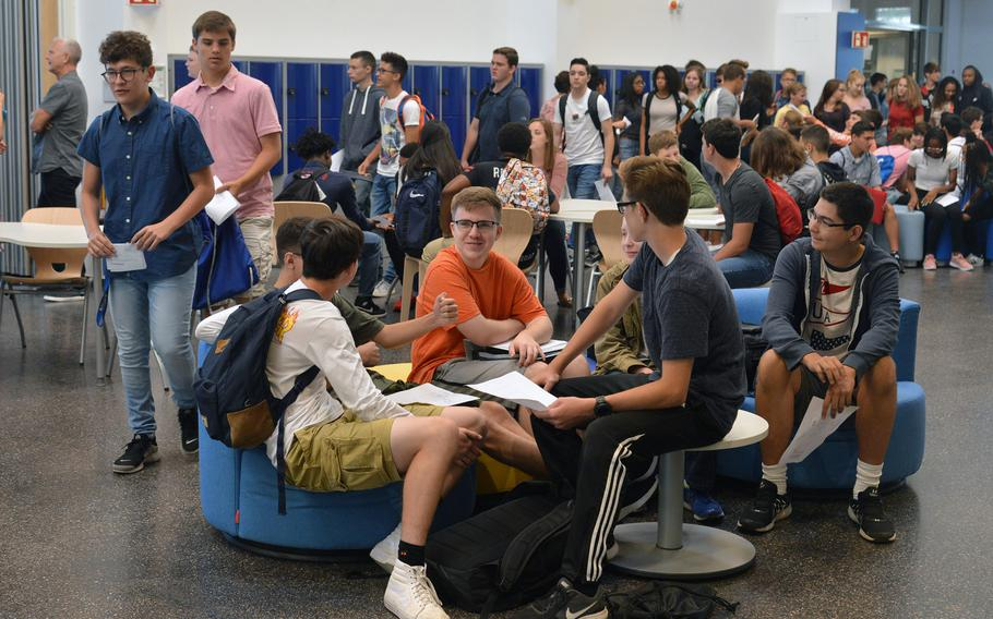 Students talk about their new school schedules and other things in the central common area of the new Wiesbaden High School as they wait to go to an orientation, Monday, Aug. 24, 2017. It is the first 21st-century-designed school in the Department of Defense Education Activity.