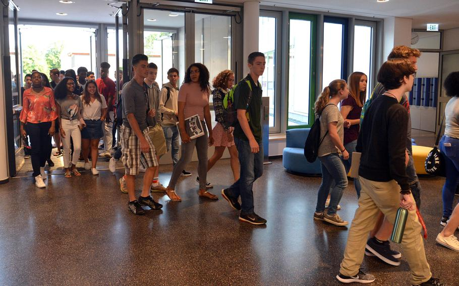Wiesbaden High School students enter their new school for the first day of the 2017-18 school year, Monday, Aug. 28, 2017. Five hundred students were enrolled on the first day of classes in the first 21st-century-designed school in the Department of Defense Education Activity.