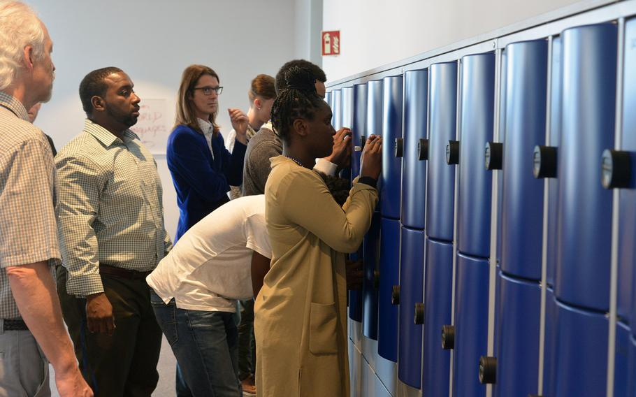 Wiesbaden High School staff help students set the combinations of their lockers on the first day of class at the new facility, the first 21st-century-designed school in the Department of Defense Education Activity.