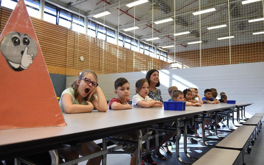 Going back to school can be exhausting. A second-grader at Ramstein Elementary School in Germany yawns while listening to a talk about cafeteria rules on Monday, Aug. 28, 2017.