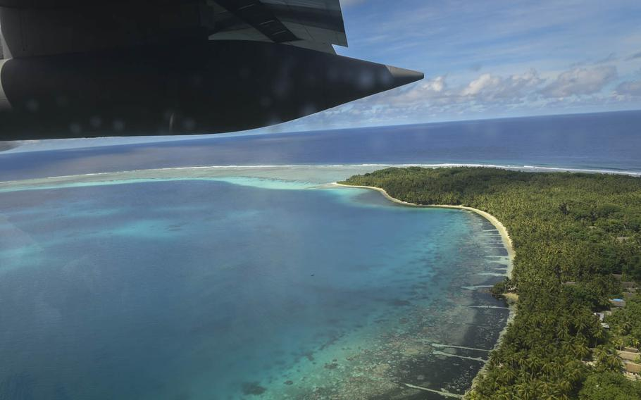 A C-130H Hercules from Yokota Air Base, Japan, flies over one of Palau's approximately 340 islands in the western Pacfiic Ocean, Dec. 11, 2016.