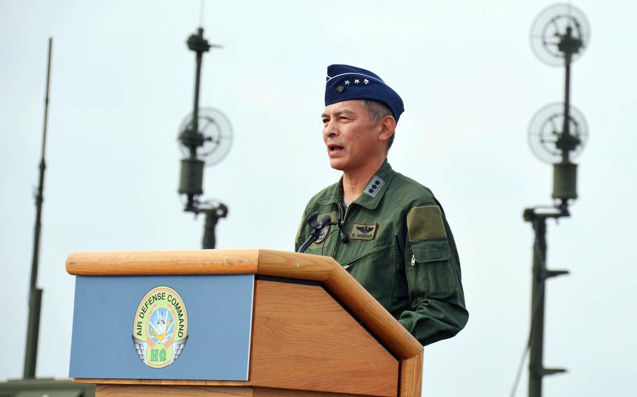 Lt. Gen. Hiroaki Maehara, chief of Japan's Air Defense Command, speaks to reporters in front of a Patriot missile-defense system at Yokota Air Base, Japan, Tuesday, Aug. 29, 2017.
