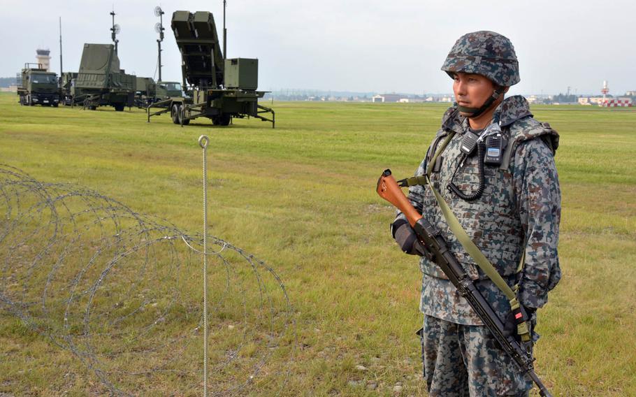 A member of the Japan Air Self-Defense Force guards a Patriot missile-defense system at Yokota Air Base, Japan, Tuesday, Aug. 29, 2017.
