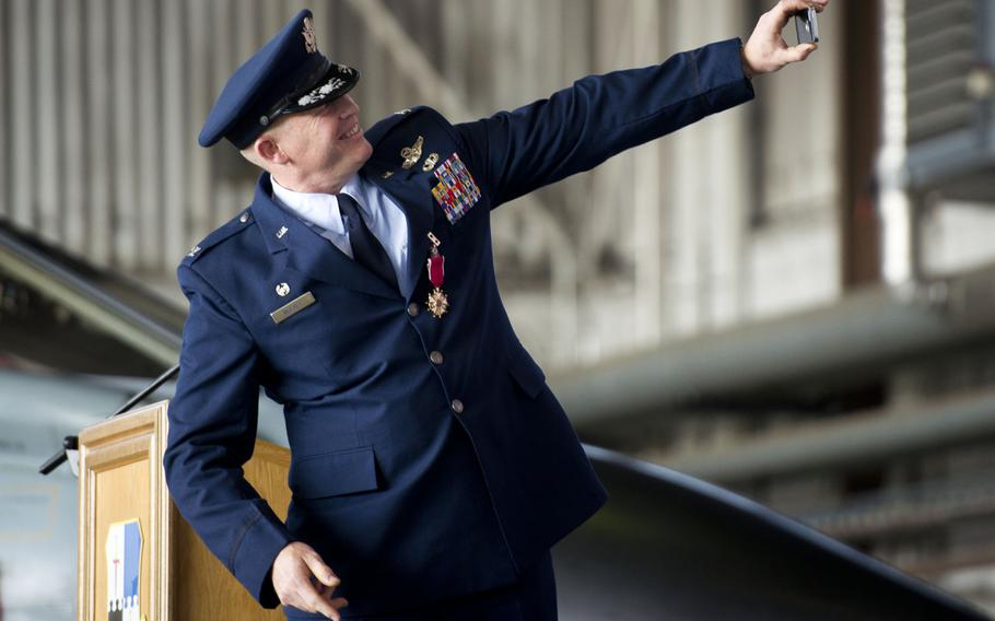 Col. Joseph McFall, outgoing 52nd Fighter Wing commander, takes a selfie during the wing's change-of-command ceremony at Spangdahlem Air Base, Germany on Tuesday, Aug. 29, 2017. McFall has been selected to be the 3rd Air Force vice commander at Ramstein Air Base, Germany.