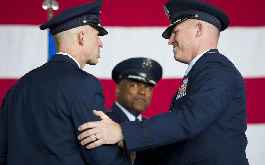 Cols. Joseph McFall, right, and Jason Bailey shake hands during the 52nd Fighter Wing's change-of-command ceremony at Spangdahlem Air Base, Germany on Tuesday, Aug. 29, 2017. Bailey assumed command of the wing from McFall during the ceremony.