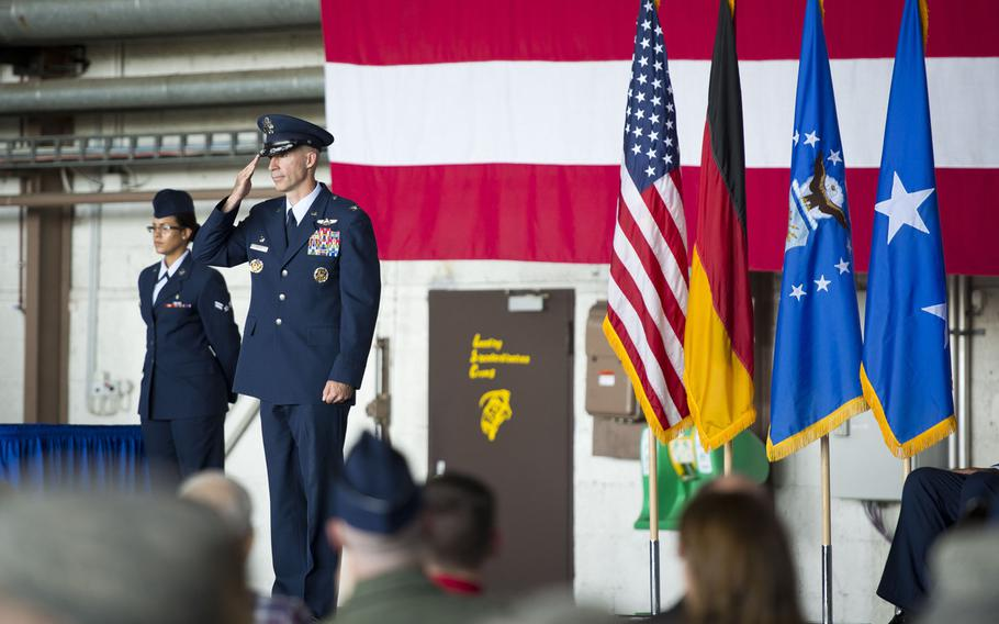 Col. Jason Bailey, 52nd Fighter Wing commander, receives his first salute from the wing during the unit's change-of-command ceremony at Spangdahlem Air Base, Germany on Tuesday, Aug. 29, 2017.