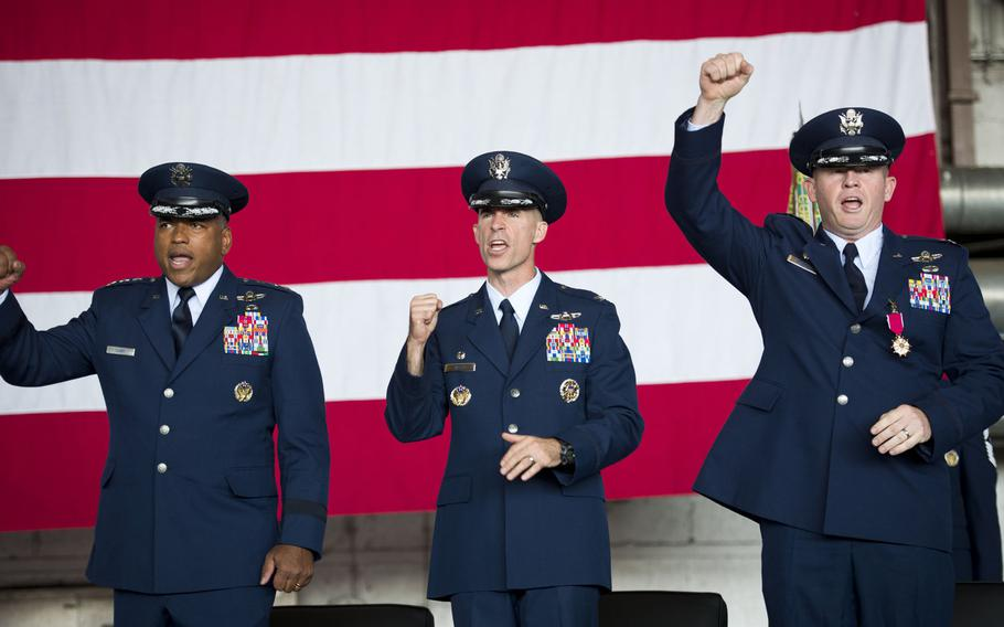 From left, 3rd Air Force Commander Lt. Gen. Richard Clark sings the Air Force song with Cols. Jason Bailey and Joseph McFall at the end of the 52nd Fighter Wing's change-of-command ceremony at Spangdahlem Air Base, Germany on Tuesday, Aug. 29, 2017.