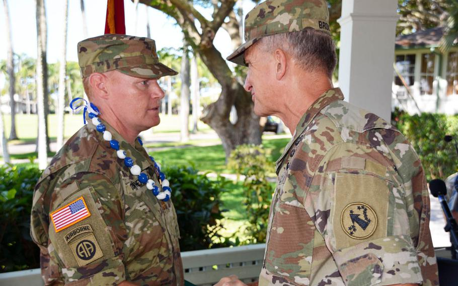 Maj. Andrew Downey receives a congratulatory handshake from Gen. Robert Brown, commander of U.S. Army Pacific, after a ceremony at Fort Shafter, Hawaii, Tuesday, Aug. 29, 2017. Downey was awarded the Soldier's Medal, the Army's highest peacetime award for valor.