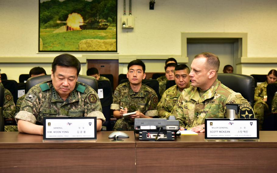 Third Republic of Korea Army commander Gen. Woon-Yong Kim meets with 2nd Infantry Division commander Maj. Gen. Scott McKean and other members of the combined U.S.-South Korean division to discuss lessons learned during annual joint war games known as Ulchi Freedom Guardian, at Camp Red Cloud, South Korea, Wednesday, Aug. 30, 2017.