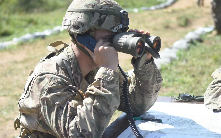 Spc. Kaden Voss is graded on calling for artillery fire during the Expert Infantry Badge certification at Hohenfels, Germany, on Wednesday, Aug. 30, 2017.