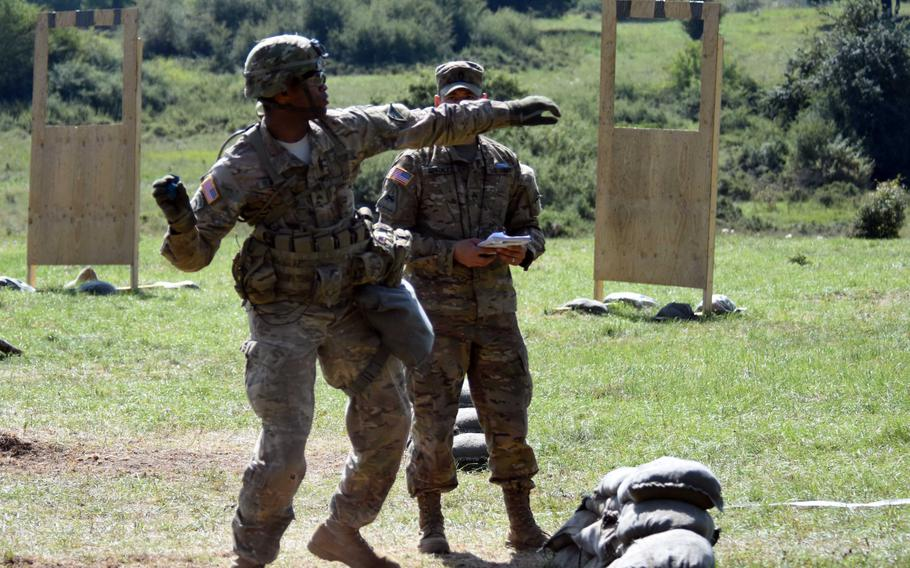Sgt. Mark Blackwell throws a practice grenade during the Expert Infantry Badge certification at Hohenfels, Germany, on Wednesday, Aug. 30, 2017.