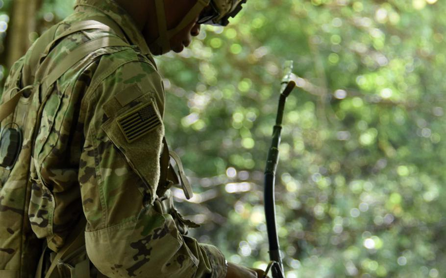 Pfc. Nicholas Jackson performs functions on a radio during Expert Infantry Badge certification at Hohenfels, Germany,  on Wednesday, Aug. 30, 2017.
