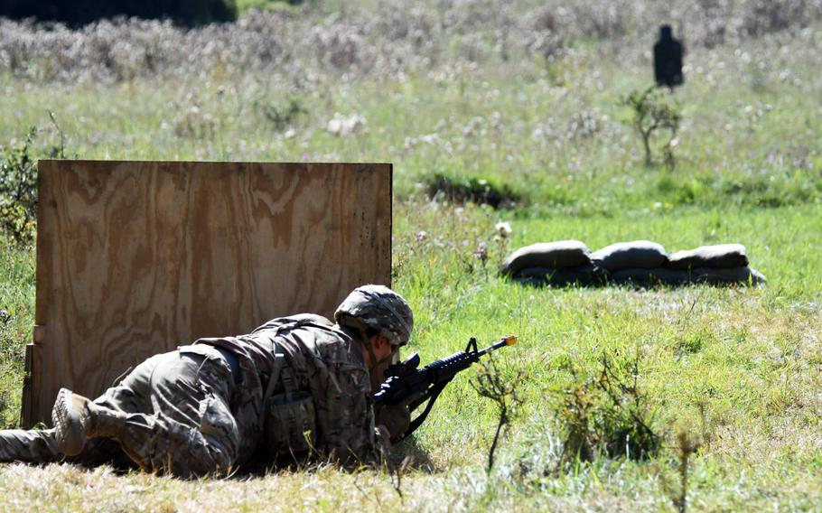 Sgt. Octavio Najera gets into position to engage a target during Expert Infantry Badge certification at Hohenfels, Germany,  on Wednesday, Aug. 30, 2017.