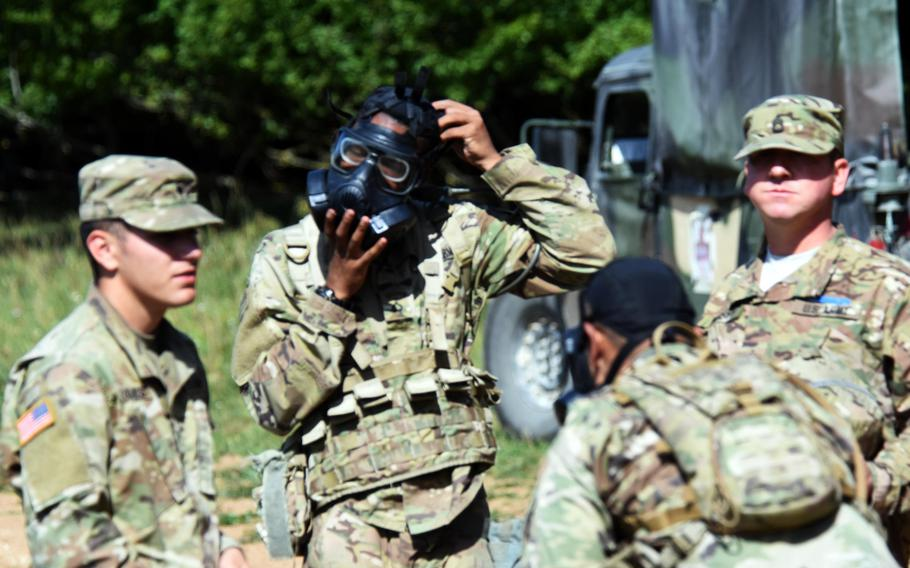 Soldiers practice quickly putting on their gas masks during Expert Infantry Badge certification at Hohenfels, Germany,  on Wednesday, Aug. 30, 2017.