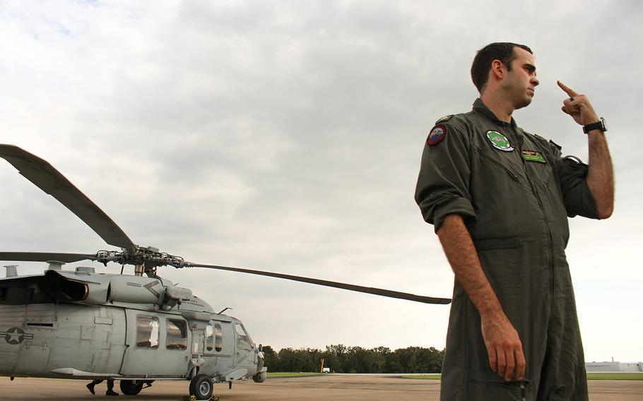 Navy pilot Lt. Cmdr. Pat Dunn talks about relief efforts during Huricane Harvey. Dunn is a part of the  Dusty Dogs of the Helicopter Sea Combat Squadron, based of out Norfolk, VA, who assisted in the rescue mission.