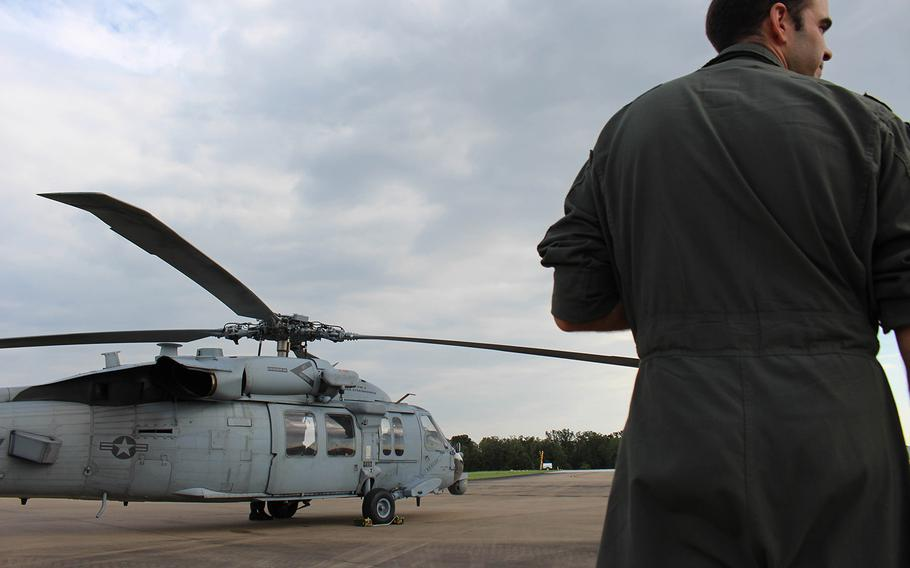 Navy pilot Lt. Cmdr. Pat Dunn gazes at a HSC-7 in College Station, TX.  Dunn is a part of the  Dusty Dogs of the Helicopter Sea Combat Squadron, based of out Norfolk, VA, who assisted in the rescue mission, caused by Hurrcane Harvey.