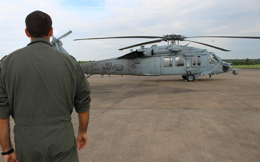 Navy pilot Lt. Cmdr. Pat Dunn walks towards a HSC-7 in College Station, TX.  Dunn is a part of the  Dusty Dogs of the Helicopter Sea Combat Squadron, based of out Norfolk, VA, who assisted in the rescue mission, caused by Hurrcane Harvey.