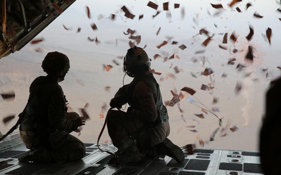 Servicemembers watch leaflets fall from a KC-130 Super Hercules over southern Afghanistan, Aug. 28, 2013. A Sept. 5, 2017, leaflet drop over Parwan province, north of Kabul, contained an image considered offensive to many in the country.